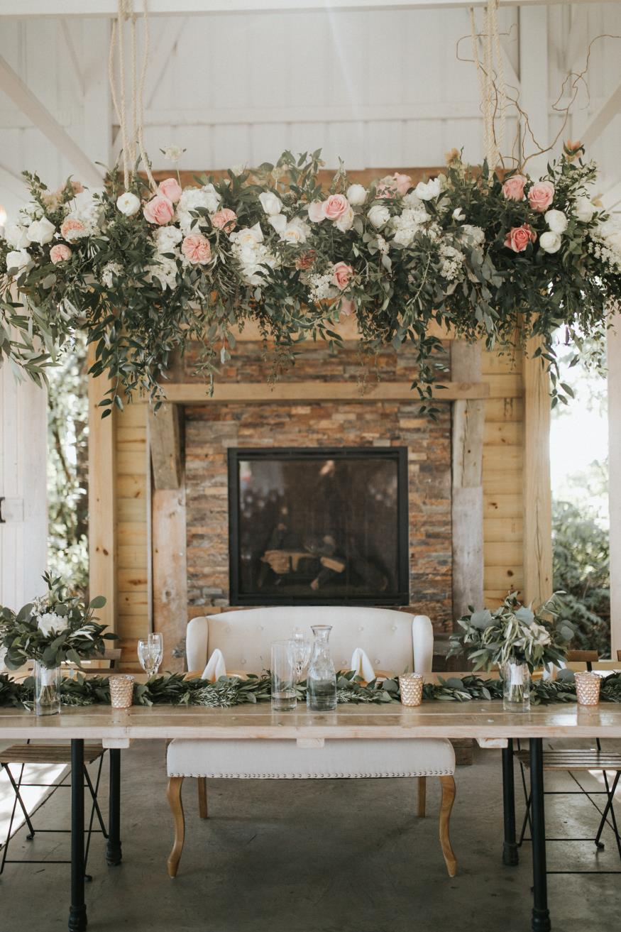 Flower Swing above head table by A to Zinnia Florals and Gifts